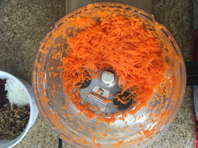 Shredded carrots in a food processor